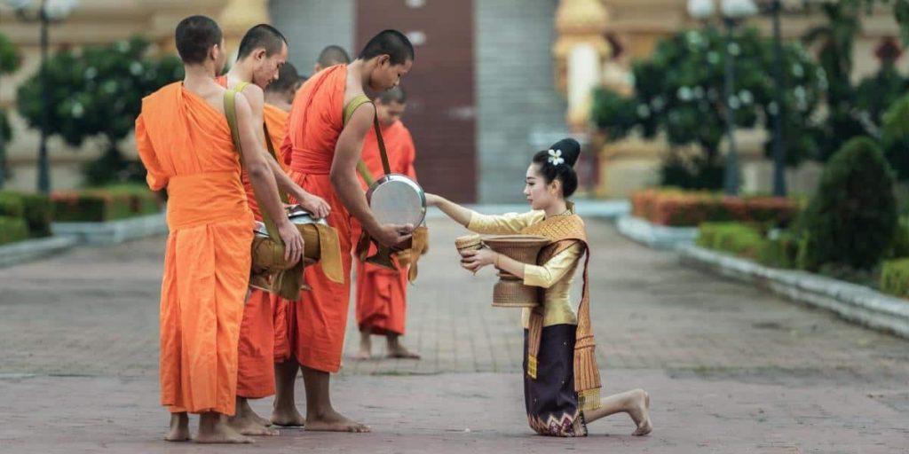 Nomadic FIRE Thailand Monk Alms e1589348068397