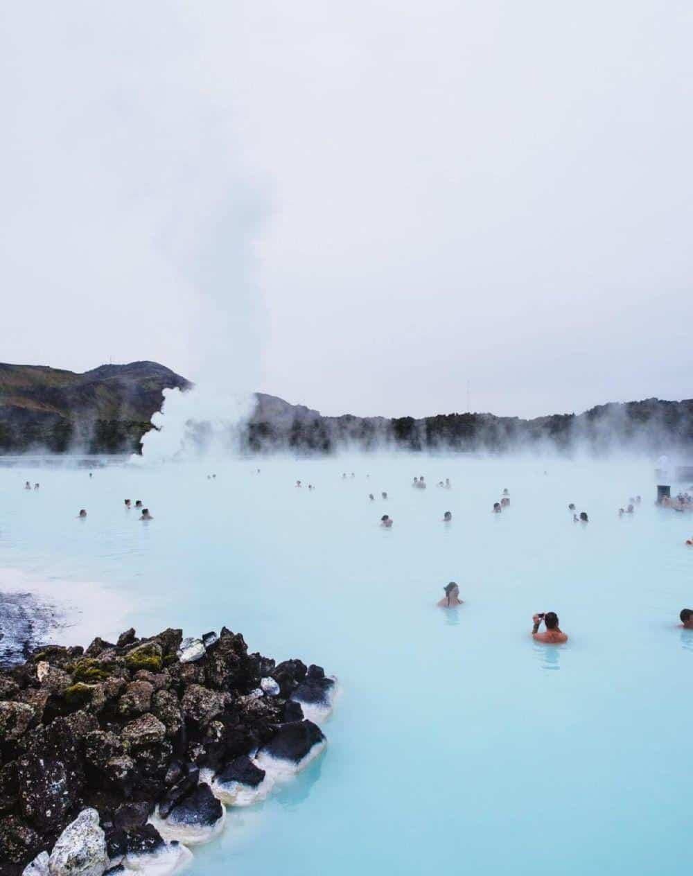 people soaking in the blue lagoon- considered one of the Top Places to Visit in Iceland