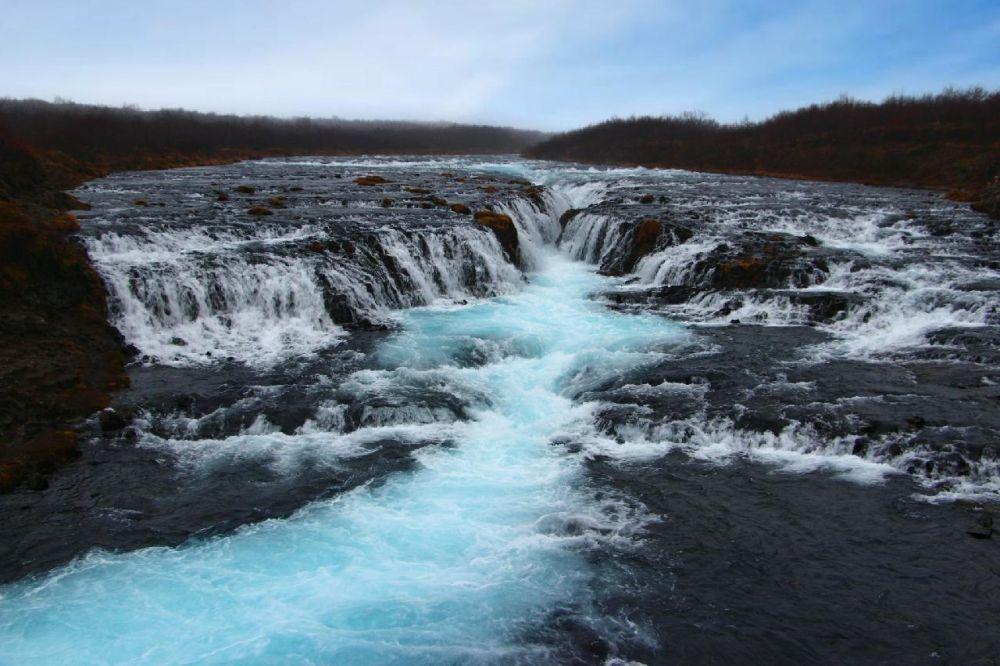 Nomadic FIRE Iceland Bruarfoss Waterfalls