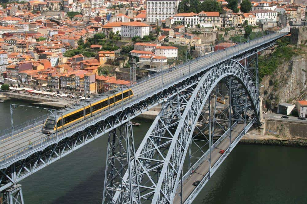 tram going over the Dom Luis Bridge considered one of the Best Things To Do in Porto